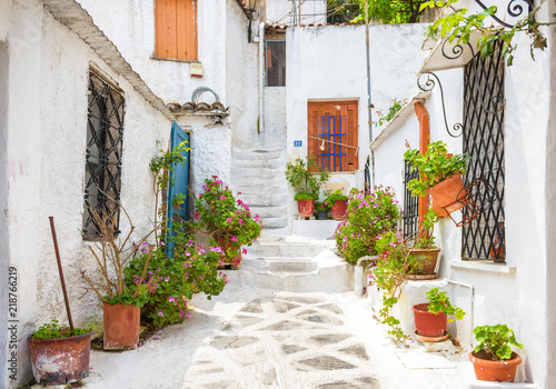 Scenic street with old houses in Anafiotika in Plaka district, Athens, Greece