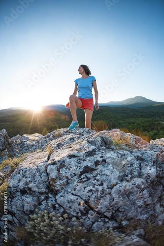 Fototapeta A girl is running in the mountains. obraz na płótnie