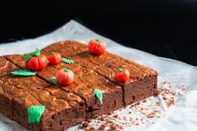 Halloween Food Idea Homemade Organic Fudge And Crispy Brownies With Fondants Pumpkins On Top On Baking Sheet