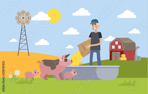 Smiling male farmer feeding pig on the farm Canvas Print