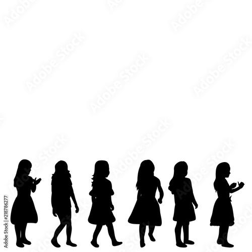 Valokuva  isolated silhouette children little girls playing