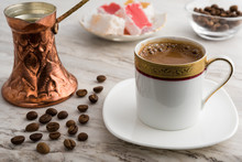 Vintage Cup Of Turkish Coffee And Traditional Bronze Coffee Pot Served On Marble With Turkish Delights