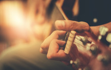 Hand Playing Acoustic Guitar, Close Up On Musical Instrument Relaxation Music Sound Hobby Passion Concept.