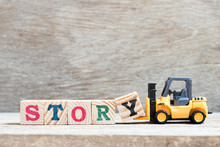 Toy Forklift Hold Letter Block Y To Complete Word Story On Wood Background