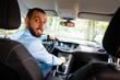 Worried businessman driving a car