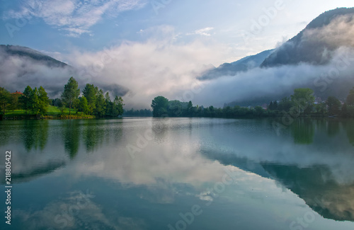 Fotografie, Obraz  Amazing view of reservoir on Soca river near Most na Soci, Slovenia at foggy mor