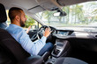 Side view of surprised man in a self-driving car