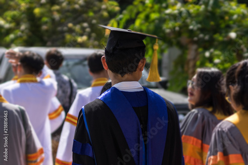 076bdd3c320 ... commencement ceremony with joyful and fun. University graduation  ceremony. Soft focus portrait of a graduate wearing black academic gown and  cap.