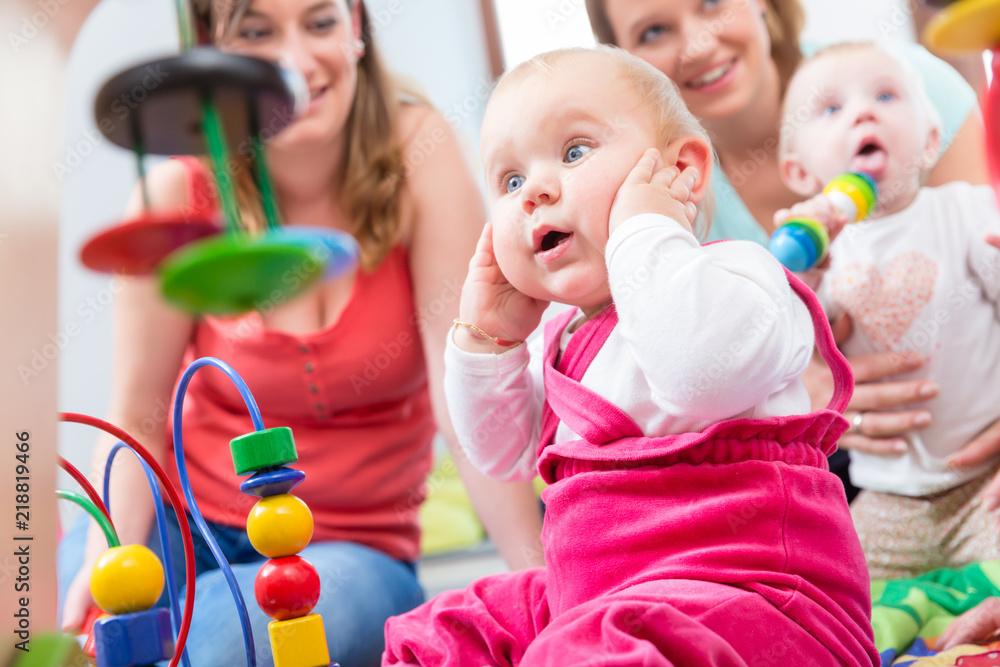Fototapeta Cute baby girl showing progress and curiosity