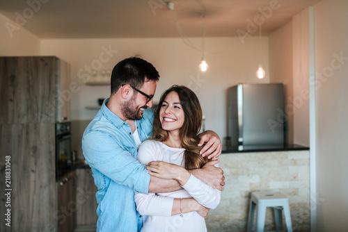 Happy couple hugging. Fotobehang