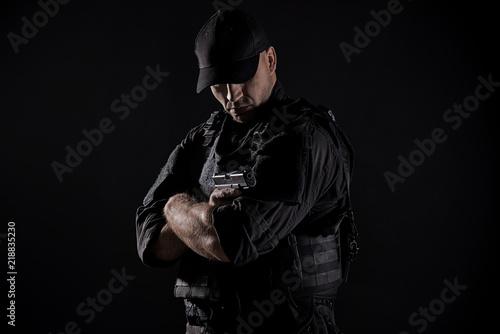 Slika na platnu Spec ops police officer SWAT in black uniform
