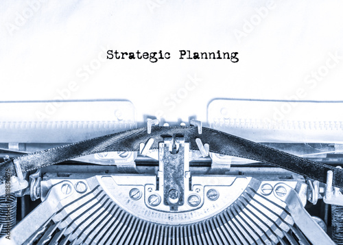 Photo  retro vintage typewriter with a sheet of paper with printed text Strategic Planning