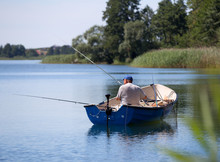 Fisherman On The Boat Poland