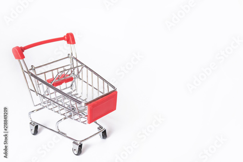 Fotografia Red Shopping cart or supermarket cart on white background with copy space
