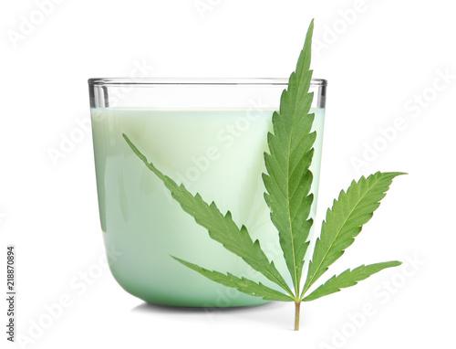 Glass with hemp milk on white background