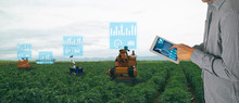 Iot Smart Agriculture Industry 4.0 Concept. Farmer Use Tablet To Control  Robot To Spot-spray Selected Weed Species And Use Mechanical Tools To Remove Other Weeds Species That Are Herbicide Resistant