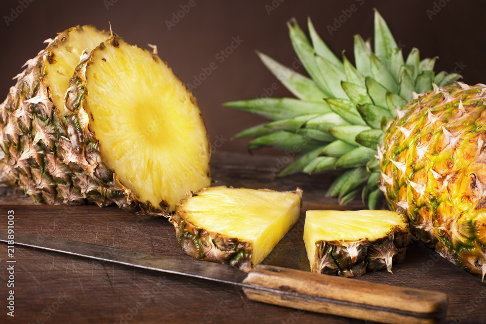 Fototapeta sliced pineapple on wooden background