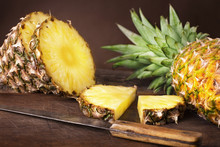 Sliced Pineapple On Wooden Bac...