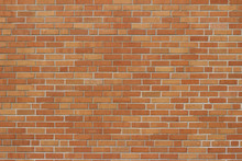 Vintage Orange Yellow Brick Wall Background With A Weathered Exterior In A Flemish Stretcher Bond Pattern