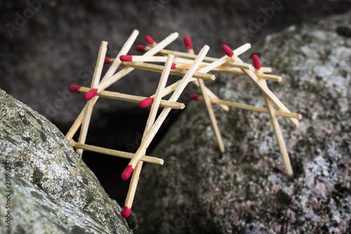leonardo da vinci's self supporting bridge built from matches between big rocks