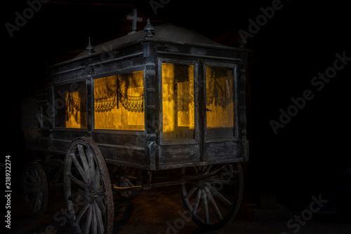 Photo  Old and dusty hearse carriage