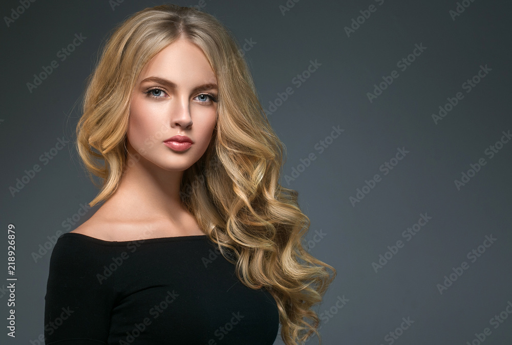 Fototapety, obrazy: Blonde hairstyle woman beauty with long curly blonde hair over dark background