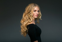 Blonde Hairstyle Woman Beauty With Long Curly Blonde Hair Over Dark Background