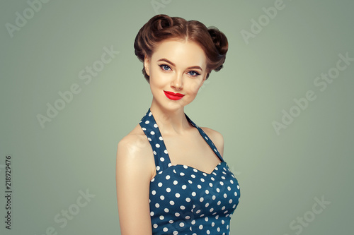 Obraz na plátně Pinup woman beauty portrait vintage retro girl model in polka dot dress
