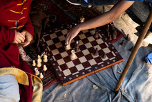 Two Men Play Chess Outdoors. C...