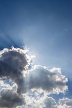 Sun Peeking Through The Cloud