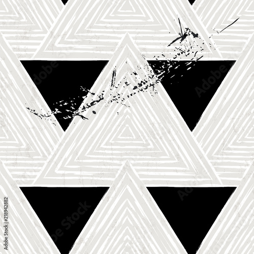 seamless geometric background pattern, with triangles, paint strokes and splashes