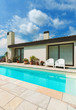 Modern architecture, beautiful white house with pool, blue sky and clouds