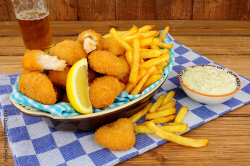 In de dag Buffet, Bar Scampi and French fries meal with tartar sauce on a wooden background
