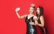 canvas print picture - Happy girls in party dresses and tiaras making vlog on smartphone