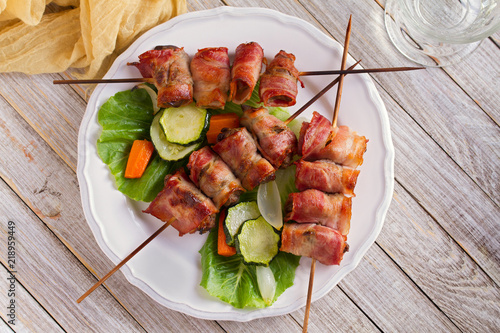 Cuadros en Lienzo Chicken liver wrapped with bacon on skewers