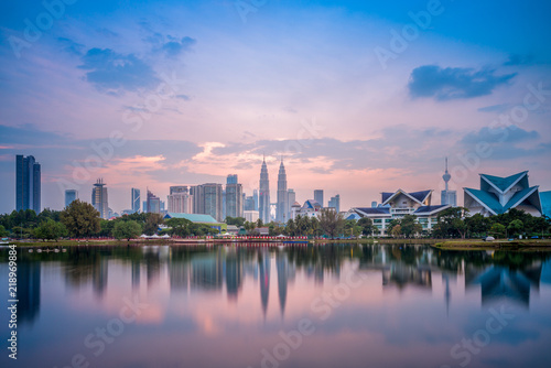Photo Stands Skyline of Kuala Lumpur by the lake at dusk