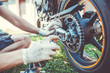 Man hands cleaning motorbike doing maintenance by rag and by detergent