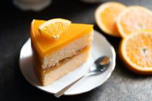 Close Up Of Orange Cake  On Th...