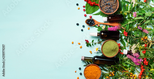 Fotografie, Obraz  Healthy super food, berries, turmeric, spirulina, omega acid capsules, vitamin c supplement, medicinal herbs and spices on blue background