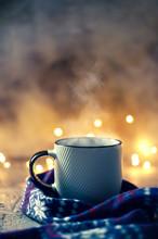 Winter Coffee Mug Covered With Wool Scarf Over Bokeh Lights