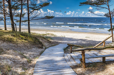 Fototapeta Morze Scenic view and resting wooden spot near a sandy beach of the Baltic Sea