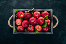 Fresh Red Apples In A Wooden B...