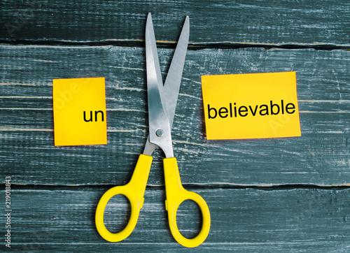 Fotografie, Obraz  scissors cut the word unbelievable