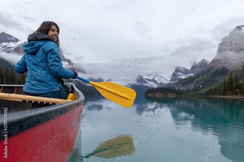 Fotografie, Obraz  Woman in Canoe on Lake in Canadian Rockies
