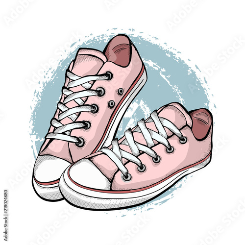 A pair of pink sneakers isolated on white background. Fototapeta