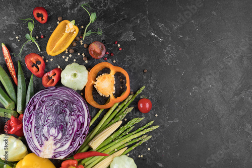 Poster Aromatische Food background. Fresh farmer vegetables at dark beton table. Space for text.