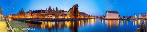 Panorama of Gdansk old town reflected in Motlawa river at dusk, Poland