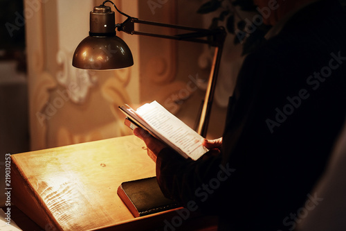 priest holding holy bible book and reading at wedding ceremony Fototapeta