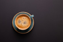 Cup Of Coffee On Black Background. Copy Space. Top View. Flat Lay.
