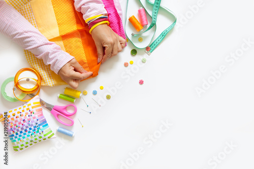 Fotobehang Stof A woman is sewing. Pechvork. Needle, scissors and fabric.
